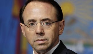 In this May 23, 2018, file photo, Deputy Attorney General Rod Rosenstein listens as President Donald Trump speaks during a roundtable on immigration policy at Morrelly Homeland Security Center in Bethpage, N.Y. (AP Photo/Evan Vucci, File)