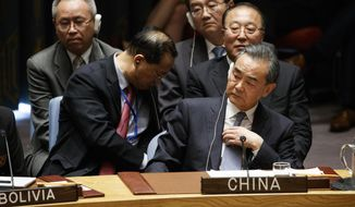 Chinese Foreign Minister Wang Yi listens as President Donald Trump speaks during a United Nations Security Council briefing on counterproliferation at the United Nations General Assembly, Wednesday, Sept. 26, 2018, at U.N. Headquarters. (AP Photo/Evan Vucci)