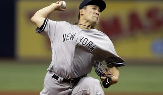 New York Yankees starting pitcher Masahiro Tanaka of Japan, delivers to the Tampa Bay Rays during the first inning of a baseball game Wednesday, Sept. 26, 2018, in St. Petersburg, Fla. (AP Photo/Chris O'Meara)