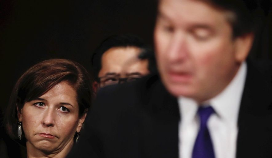 Ashley Estes Kavanaugh watches husband, Supreme Court nominee Brett M. Kavanaugh testify before the Senate Judiciary Committee. (Associated Press)