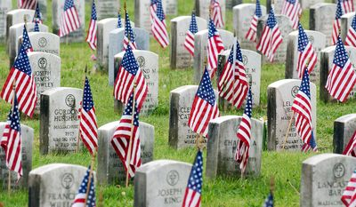 U.S. flags mark each grave in the WW I veteran section of the Mount Hope Cemetery in Boston, Saturday, May 24, 2003. The city of Boston places the flags each year in observance of Memorial Day. (AP Photo/Michael Dwyer)