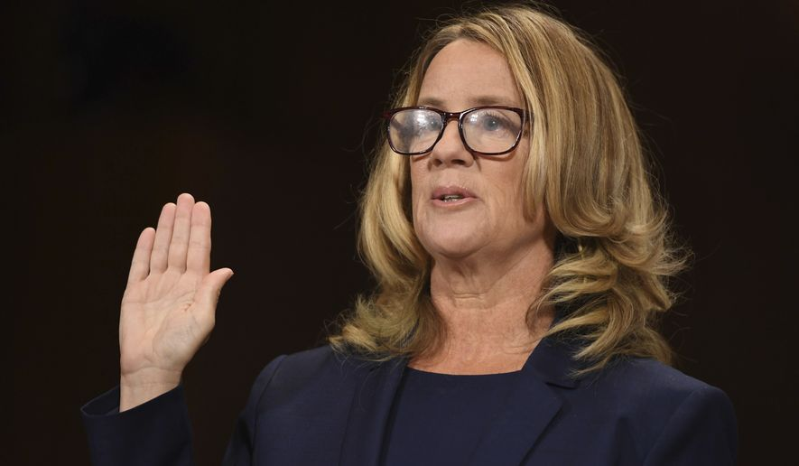 Christine Blasey Ford is sworn in to testify before the Senate Judiciary Committee on Capitol Hill in Washington, Thursday, Sept. 27, 2018. (Saul Loeb/Pool Photo via AP)