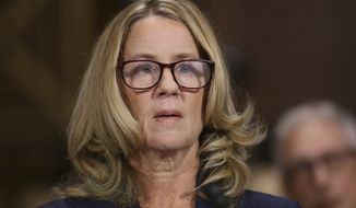 Christine Blasey Ford arrives to testify before the Senate Judiciary Committee on Capitol Hill in Washington, Thursday, Sept. 27, 2018. (Win McNamee/Pool Image via AP)