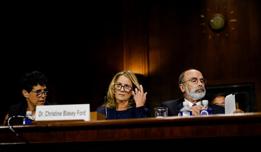 Christine Blasey Ford, with lawyers Debra S. Katz, left, and Michael R. Bromwich, at a Senate Judiciary Committee hearing on Thursday, September 27, 2018 on Capitol Hill. (Melina Mara /The Washington Post via AP, Pool)