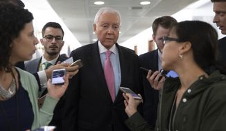 Sen. Orrin Hatch, R-Utah, a senior member of the Senate Judiciary Committee, is surrounded by reporters during a break as they hearing testimony from Christine Blasey Ford on Capitol Hill in Washington, Thursday, Sept. 27, 2018. (AP Photo/J. Scott Applewhite)