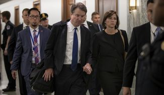 Supreme Court nominee Brett Kavanaugh and his wife Ashley Estes Kavanaugh depart after testifying before the Senate Judiciary Committee on Capitol Hill in Washington, Thursday, Sept. 27, 2018. (AP Photo/J. Scott Applewhite)