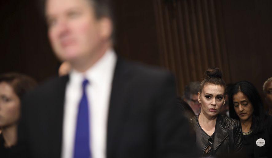 Actress Alyssa Milano listens as Supreme court nominee Brett Kavanaugh testifies before the Senate Judiciary Committee on Capitol Hill in Washington, Thursday, Sept. 27, 2018. (Saul Loeb/Pool Photo via AP)