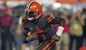 FILE - In this Thursday, Sept. 20, 2018, file photo, Cleveland Browns quarterback Tyrod Taylor rushes during the first half of an NFL football game against the New York Jets in Cleveland. Taylor returned to practice Thursday, Sept. 27, 2018, after suffering a concussion last week. (AP Photo/David Richard, File)