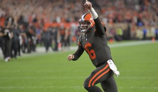 FILE - In this Sept. 20, 2018, file photo, Cleveland Browns quarterback Baker Mayfield celebrates during the team's NFL football game against the New York Jets in Cleveland. No. 1 overall draft pick Mayfield is set to make his debut as an NFL starter on Sunday when the Browns visit Jon Gruden and the Oakland Raiders a week after he led a comeback win in relief that snapped Cleveland's 19-game winless streak. (AP Photo/David Richard, File)