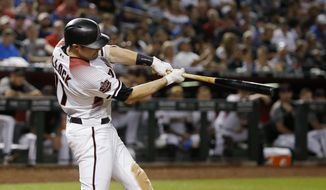 Arizona Diamondbacks' A.J. Pollock swings on a three-run home run against the Los Angeles Dodgers during the fifth inning of a baseball game Wednesday, Sept. 26, 2018, in Phoenix. (AP Photo/Ross D. Franklin)