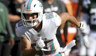FILE - In this Sept. 16, 2018, file photo, Miami Dolphins wide receiver Danny Amendola is shown in action against the New York Jets during an NFL football game, in East Rutherford, N.J. For any New England Patriots wanting to say hello Sunday to former teammate Danny Amendola, they're most likely to find him running over the middle.But they already knew that. That's where Amendola made his living for five years with the Patriots, and that's where he has made an impact so far with his new team, the Miami Dolphins. (Brad Penner/AP Photo, File)