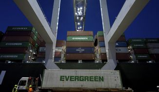 In this June, 19, 2018, file photo, an Evergreen Line refrigerated container is delivered to a ship-to-shore crane working the container ship Ever Linking at the Port of Savannah in Savannah, Ga. On Thursday, Sept. 27, the Commerce Department issues the final estimate of how the U.S. economy performed in the April-June quarter. (AP Photo/Stephen B. Morton, File)