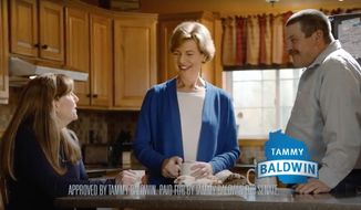 This photo from a television campaign ad provided by the Tammy Baldwin for Senate campaign shows Wisconsin Democratic Sen. Tammy Baldwin, center, talking with Marv and Linda Simcakoski, the parents of a Marine veteran who died at the Tomah Veterans Affairs Medical Center. The spot is one of two ads released Thursday, Sept. 27, 2018, in an attempt by Baldwin to counter one of the main criticisms of her lodged by Republican opponent Leah Vukmir and allied conservative groups. Vukmir has charged that Baldwin failed to respond quickly enough to the crisis at Tomah, where veterans were being over-prescribed opioids. (Tammy Baldwin for Senate campaign)