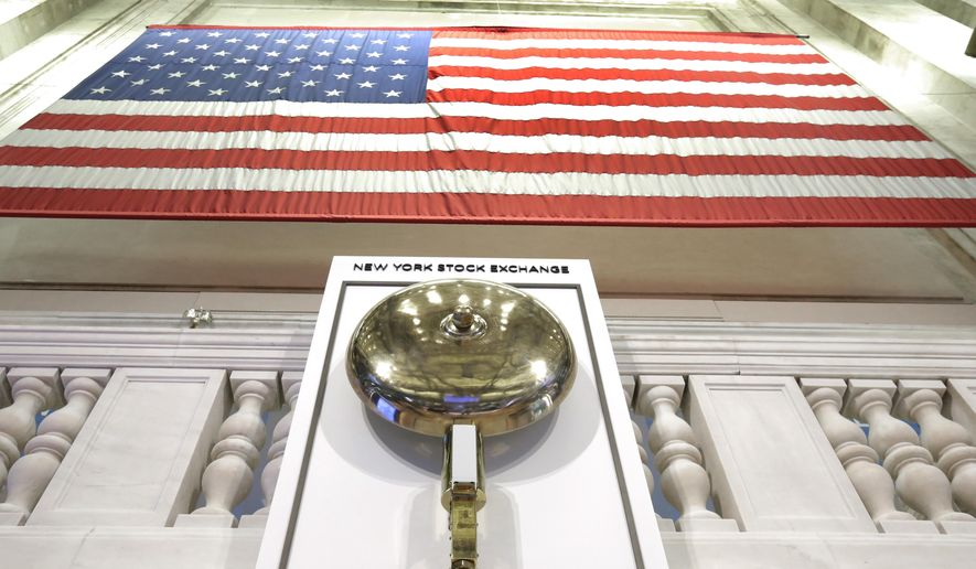 FILE- In this May 17, 2018, file photo an American flag hangs above the bell podium on the floor of the New York Stock Exchange. The U.S. stock market opens at 9:30 a.m. EDT on Thursday, Sept. 27 (AP Photo/Richard Drew, File)