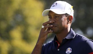 Tiger Woods of the US stands on the fairway during a practice round for the 2018 Ryder Cup at Le Golf National in Saint-Quentin-en-Yvelines, outside Paris, France, Thursday, Sept. 27, 2018. The 42nd Ryder Cup will be held in France from Sept. 28-30, 2018, at the Albatros Course of Le Golf National. (AP Photo/Francois Mori)