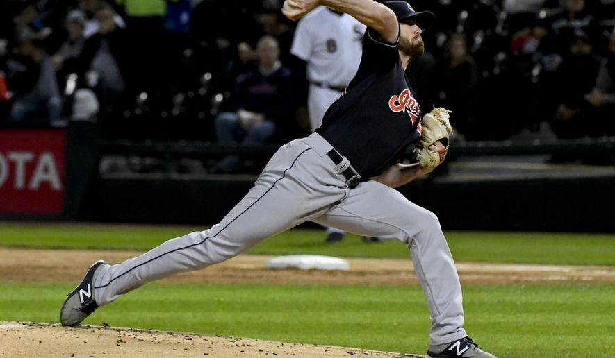 Cleveland Indians starting pitcher Shane Bieber (57) delivers against the Chicago White Sox during the first inning of a baseball game in Chicago on Wednesday, Sept.26, 2018. (AP Photo/Matt Marton)