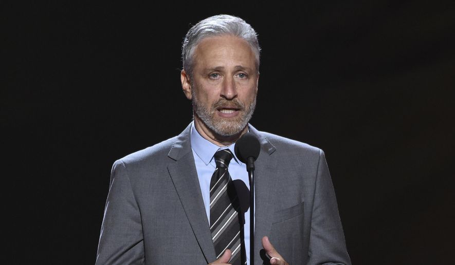 FILE- In this July 18, 2018, file photo on Stewart presents the Pat Tillman award for service at the ESPY Awards at Microsoft Theater in Los Angeles. Stewart surprised construction workers at a New Jersey performing arts theater with a free lunch. Stewart appeared behind the window of the Shore Good Eats food truck outside the Count Basie Center of the Arts in Red Bank, Wednesday, Sept. 26, handing out sandwiches and cookies. (Photo by Phil McCarten/Invision/AP, File)