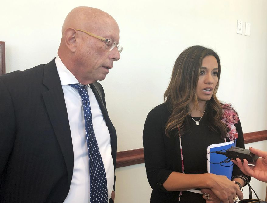 State. Rep. Monica Youngblood, R-Albuquerque, with her attorney Paul Kennedy, speaks to reporters on Tuesday, Sept. 25, 2018, after her trial in a DWI case at a courthouse in Albuquerque, N.M. A judge on Tuesday found Youngblood guilty of aggravated drunken driving, citing her performance and seemingly flippant demeanor during a field sobriety test last spring. (AP Photo/Mary Hudetz)