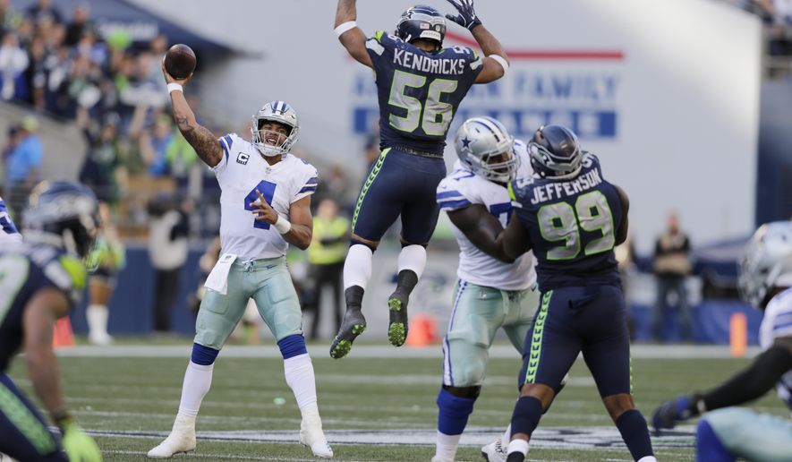 FILE - In this Sept. 23, 2018, file photo, Seattle Seahawks linebacker Mychal Kendricks (56) leaps as Dallas Cowboys quarterback Dak Prescott (4) attempts a pass during the second half of an NFL football game in Seattle. The Cowboys, who can't find anything remotely resembling a rhythm with quarterback Dak Prescott and a new group of receivers, are at home this week against the Detroit Lions. (AP Photo/John Froschauer, File)