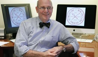 FILE - This Thursday, Dec. 29, 2011 file photo shows Dr. Jeffrey M. Drazen, editor-in-chief of the New England Journal of Medicine, in the magazine's editorial offices in Boston. Drazen, 72, an asthma and lung disease expert at Brigham and Women's Hospital in Boston, became editor in 2000 and is one of the journal's longest-serving chiefs. (AP Photo/Michael Dwyer)