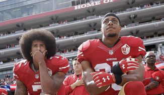 FILE - In this Oct. 2, 2016, file photo, San Francisco 49ers quarterback Colin Kaepernick, left, and safety Eric Reid kneel during the national anthem before an NFL football game against the Dallas Cowboys in Santa Clara, Calif. The Carolina Panthers have signed the free agent safety to a one-year contract. Terms of the deal were not announced Thursday, Sept. 27, 2018. (AP Photo/Marcio Jose Sanchez, File) **FILE**