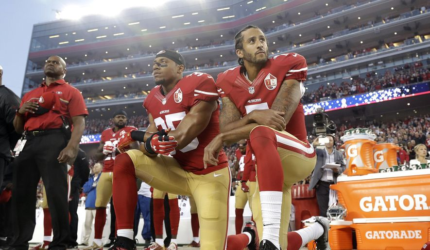 FILE - In this Sept. 12, 2016, file photo, San Francisco 49ers safety Eric Reid (35) and quarterback Colin Kaepernick (7) kneel during the national anthem before an NFL football game against the Los Angeles Rams in Santa Clara, Calif. The Carolina Panthers have signed free agent safety Eric Reid to a one-year contract. Terms of the deal were not announced Thursday, Sept. 27, 2018.  (AP Photo/Marcio Jose Sanchez, File)