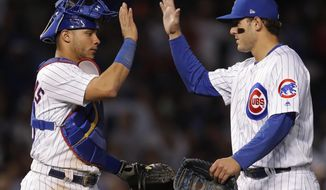 Chicago Cubs' Willson Contreras, left, and Anthony Rizzo celebrate the team's 3-0 win against the Pittsburgh Pirates in a baseball game Thursday, Sept. 27, 2018, in Chicago. (AP Photo/Jim Young)