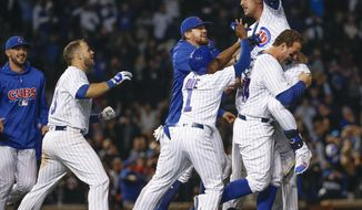 Chicago Cubs' Albert Almora Jr., top, celebrates with teammates after hitting a walk-off single against the Pittsburgh Pirates during the 10th inning of a baseball game Wednesday, Sept. 26, 2018, in Chicago. (AP Photo/Kamil Krzaczynski)