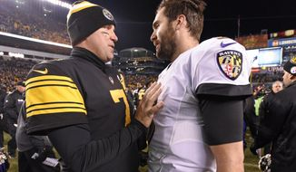 FILE - In this Dec. 25, 2016, file photo, Pittsburgh Steelers quarterback Ben Roethlisberger (7) talks with Baltimore Ravens quarterback Joe Flacco (5) following an NFL football game in Pittsburgh. The Ravens will try to end a three-game losing streak to the rival Steelers when the two AFC North rivals meet on Sunday night, Sept. 30, 2018. (AP Photo/Don Wright, File)