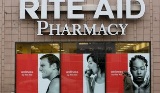 FILE - In this Feb. 10, 2017, file photo, a man walks by a Rite Aid pharmacy in the Oakland section of Pittsburgh. After two failed buyouts, Rite Aid will shuffle its board of directors and spread out leadership at the top of the drugstore chain. Rite Aid said Thursday, Sept. 27, 2018, that three new, independent directors will be nominated to its board, and CEO John Standley will no longer hold the title of chairman. That will go to current board member Bruce Bodaken. (AP Photo/Gene J. Puskar, File)