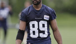 FILE - In this May 24, 2018, file photo, Seattle Seahawks wide receiver Doug Baldwin walks off the field following NFL football practice, in Renton, Wash. Baldwin is back practicing for the Seattle Seahawks in the hope he can return in Week 4 vs. Arizona after sitting out with a sprained knee. (AP Photo/Ted S. Warren, File)