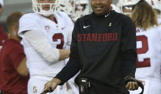 Stanford coach David Shaw gestures toward the referees during the second half of their NCAA college football game against Oregon Saturday, Sept. 22, 2018, in Eugene, Ore. (AP Photo/Chris Pietsch)