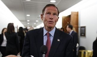 Sen. Richard Blumenthal, D-Conn., speaks to media during a break in a Senate Judiciary Committee hearing on Capitol Hill in Washington, Thursday, Sept. 27, 2018, with Christine Blasey Ford and Supreme Court nominee Brett Kavanaugh. (AP Photo/Carolyn Kaster) ** FILE **