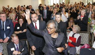 Anita Hill waves as she arrives for speech at the University of Utah Wednesday, Sept. 26, 2018, in Salt Lake City. Hill has been back in the spotlight since Christine Blasey Ford accused Supreme Court nominee Brett Kavanaugh of sexually assaulting her when the two were in high school. Hill's 1991 testimony against Clarence Thomas riveted the nation. Thomas was confirmed anyway, but the hearing ushered in a new awareness of sexual harassment. (AP Photo/Rick Bowmer)