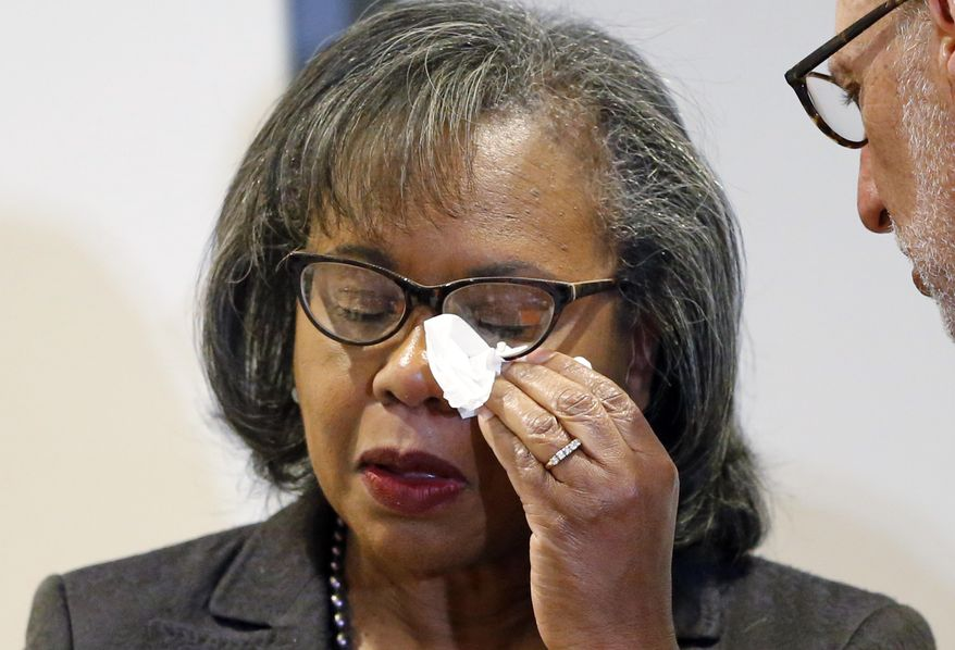 Anita Hill wipes her eye after speaking at the University of Utah Wednesday, Sept. 26, 2018, in Salt Lake City. Hill has been back in the spotlight since Christine Blasey Ford accused Supreme Court nominee Brett Kavanaugh of sexually assaulting her when the two were in high school. Hill's 1991 testimony against Clarence Thomas riveted the nation. Thomas was confirmed anyway, but the hearing ushered in a new awareness of sexual harassment. (AP Photo/Rick Bowmer)