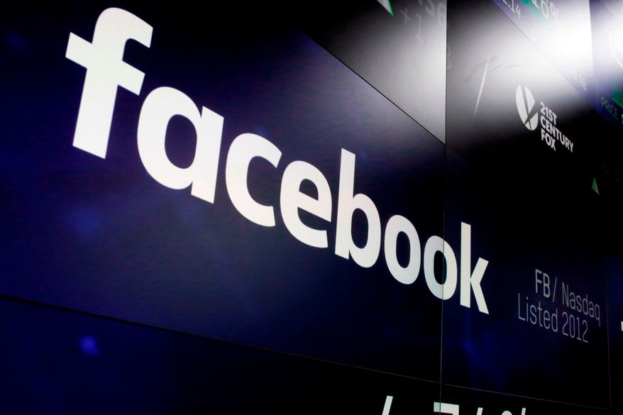 """In this March 29, 2018, file photo, the logo for Facebook appears on screens at the Nasdaq MarketSite in New York's Times Square.  Facebook says it recently discovered a security breach affecting nearly 50 million user accounts. The hack is the latest setback for Facebook during a year of tumult for the global social media service. In a blog post , Friday, Sept. 28, the company says hackers exploited its """"View As"""" feature, which lets people see what their profiles look like to someone else (AP Photo/Richard Drew, File)"""