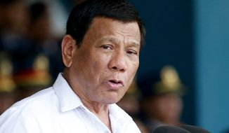 In this Wednesday, Aug. 8, 2018, file photo, President Rodrigo Duterte gestures while addressing police force to mark the 117th Philippine National Police Service anniversary Quezon city northeast of Manila, Philippines.  (AP Photo/Bullit Marquez, File) **FILE**