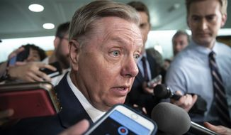 Sen. Lindsey Graham, R-S.C., a member of the Senate Judiciary Committee, responds to reporters after Sen. Jeff Flake, R-Ariz., a member of the committee, called for the FBI to investigate the sexual misconduct claims against Supreme Court nominee Brett Kavanaugh, on Capitol Hill in Washington, Friday, Sept. 28, 2018. Graham says it's going to fall to him to lay out to President Donald Trump why Brett Kavanaugh's Supreme Court confirmation vote has been delayed. (AP Photo/J. Scott Applewhite)