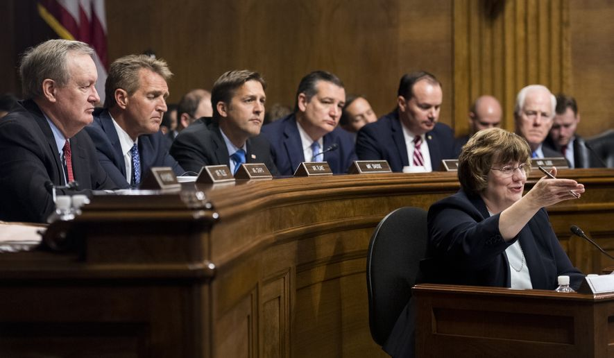 Rachel Mitchell, counsel for Senate Judiciary Committee Republicans, questions Dr. Christine Blasey Ford as Senators, from left, Mike Crapo, R-Idaho, Jeff Flake, R-Ariz., Ben Sasse, R-Neb., Ted Cruz, R-Texas, Mike Lee, R-Utah., and John Cornyn, R-Texas, listen during the Senate Judiciary Committee hearing on the nomination of Brett M. Kavanaugh to be an associate justice of the Supreme Court of the United States, focusing on allegations of sexual assault by Kavanaugh against Christine Blasey Ford in the early 1980s. (Tom Williams/Pool Photo via AP)