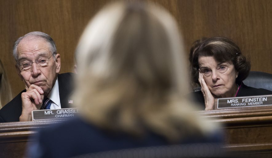Chairman Charles Grassley, R-Iowa, and ranking member Sen. Dianne Feinstein, D-Calif., listen to Dr. Christine Blasey Ford on Sept. 27, 2018, testify during the Senate Judiciary Committee hearing on the nomination of Judge Brett M. Kavanaugh to be an associate justice of the Supreme Court of the United States, focusing on allegations of sexual assault by Kavanaugh against Christine Blasey Ford in the early 1980s. (Tom Williams/Pool Photo via AP) ** FILE **