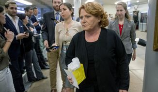 "In this Sept. 25, 2018 file photo, Sen. Heidi Heitkamp, D-N.D., walks through the Senate Subway as she arrive at the Capitol, in Washington. Heitkamp suggested Friday, Sept. 28 she may vote no on Brett Kavanaugh's confirmation to the Supreme Court, saying ""There are a lot of lawyers in America who can sit on the court"" and Kavanaugh isn't the only person who can do the job."" (AP Photo/Andrew Harnik, File)"