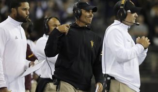 Arizona State head coach Herm Edwards, second from right, reacts to a play on the sideline during the second half of an NCAA college football game against Washington, Saturday, Sept. 22, 2018, in Seattle. Washington won 27-20. (AP Photo/Ted S. Warren)