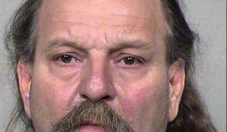 This undated photo provided by the Maricopa County Sheriff's Office shows 59-year-old Charles Eugene Robbins of Phoenix, who was booked Wednesday, Sept. 26, 2018, on suspicion of murder in the 2014 ax-bludgeoning death of 40-year-old Joshua C. Calkins in Phoenix. Robbins is the second man to be charged with murder in Calkins' death. Christopher Paul Mason was charged nearly four years ago with murder and other charges in Calkins' death. (Maricopa County Sheriff's Office via AP)