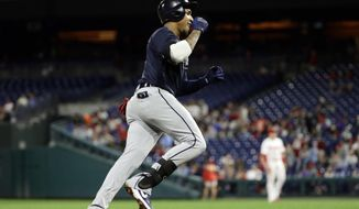 Atlanta Braves' Johan Camargo rounds the bases after hitting a home run off Philadelphia Phillies starting pitcher Jerad Eickhoff during the fourth inning of a baseball game Friday, Sept. 28, 2018, in Philadelphia. (AP Photo/Matt Slocum)