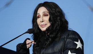 In this Jan. 21, 2018, file photo, Cher speaks during a women's march rally in Las Vegas. (AP Photo/John Locher)