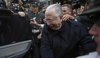 "FILE - In this Nov. 11, 2015 file photo, Fernando Karadima is escorted from a court, after testifying in a case that three of his victims brought against the country's Catholic Church in Santiago, Chile. Pope Francis has on Friday, Sept. 29, 2018, defrocked Karadima, a priest at the center of the global sex abuse scandal rocking his papacy, invoking his ""supreme"" authority to stiffen a sentence originally handed down by a Vatican court in 2011. (AP Photo/Luis Hidalgo, File)"