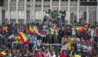 "FILE - In this Saturday, June 23, 2018, file photo, Ethiopians rally in solidarity with Prime Minister Abiy Ahmed, before a deadly explosion struck the huge rally in Meskel Square in the capital, Addis Ababa, Ethiopia. Ethiopia's attorney general on Friday, Sept. 28, 2018 filed terrorism charges against five people accused of trying to ""kill the prime minister"" at the rally in June. (AP Photo/Mulugeta Ayene, File)"