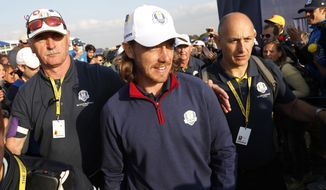 Europe's Tommy Fleetwood leaves the course after winning his foursome match on the opening day of the 42nd Ryder Cup at Le Golf National in Saint-Quentin-en-Yvelines, outside Paris, France, Friday, Sept. 28, 2018. Molinari and Fleetwood beat Justin Thomas of the US and Jordan Spieth 5 and 4. (AP Photo/Laurent Cipriani)