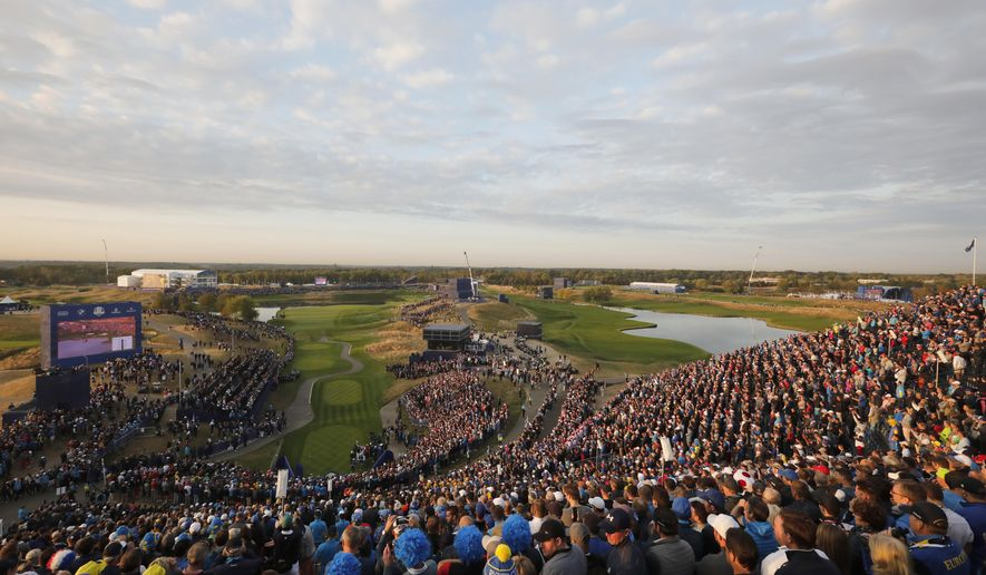 General view of the 1st hole as players prepare to start their fourball match on the opening day of the 2018 Ryder Cup at Le Golf National in Saint-Quentin-en-Yvelines, outside Paris, France, Friday, Sept. 28, 2018. (AP Photo/Laurent Cipriani)
