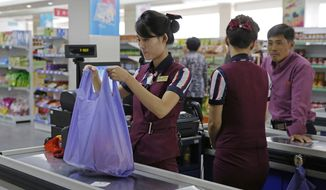 In this Sept. 12, 2018 photo, North Korean shop assistants work at a supermarket in Pyongyang, North Korea. In the era of Kim Jong Un, North Korea is learning to embrace its inner consumer. The rise of the consumer is a major feature, not a bug, of Kim's plans to strengthen the country's sad-sack economy and lift the people's standard of living.  (AP Photo/Kin Cheung)